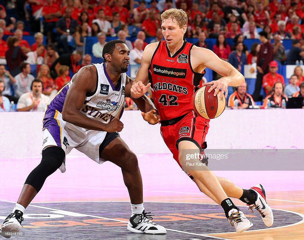 Shawn Redhage of the Wildcats drives to the basket against Darnell Lazare of the Kings during the round 22 NBL match between the Perth Wildcats and the Sydney Kings at Perth Arena on March 8, 2013 in Perth, Australia.