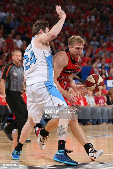 Shawn Redhage of the Wildcats drives to the basket against Dillon Boucher of the Breakers during game two of the NBL Grand Final series between the...