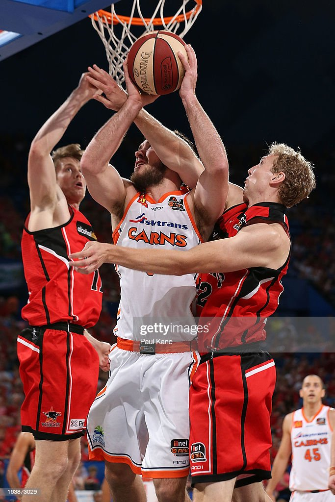 Shawn Redhage of the Wildcats fouls Brad Hill of the Taipans during the round 23 NBL match between the Perth Wildcats and the Cairns Taipans at Perth Arena on March 17, 2013 in Perth, Australia.