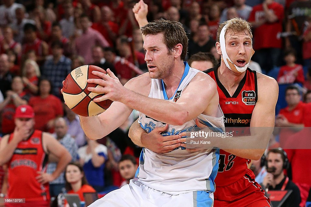 Shawn Redhage of the Wildcats fouls Dillon Boucher of the Breakers during game two of the NBL Grand Final series between the Perth Wildcats and the...