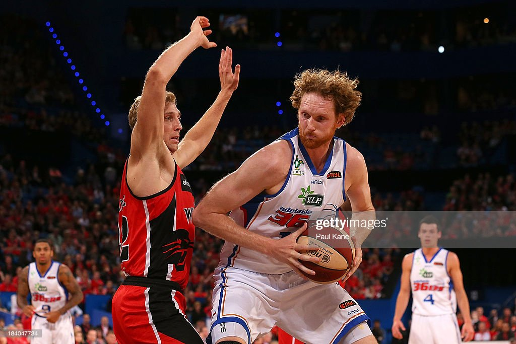 Shawn Redhage of the Wildcats holds out Luke Schenscher of the 36ers during the round one NBL match between the Perth Wildcats and the Adelaide 36ers...