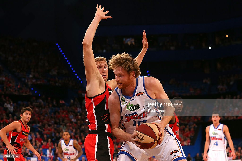 Shawn Redhage of the Wildcats holds out <a gi-track='captionPersonalityLinkClicked' href=/galleries/search?phrase=Luke+Schenscher&family=editorial&specificpeople=207134 ng-click='$event.stopPropagation()'>Luke Schenscher</a> of the 36ers during the round one NBL match between the Perth Wildcats and the Adelaide 36ers at Perth Arena in October 11, 2013 in Perth, Australia.
