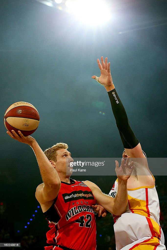 Shawn Redhage of the Wildcats looks to layup against Seth Scott of the Tigers during the round 20 NBL match between the Perth Wildcats and the Melbourne Tigers at Perth Arena on February 21, 2013 in Perth, Australia.