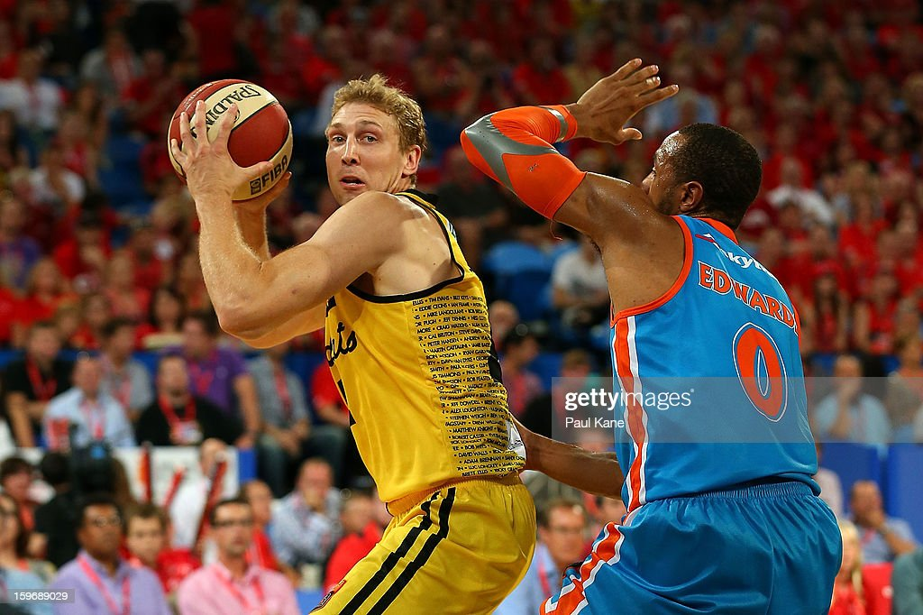 Shawn Redhage of the Wildcats looks to pass against Shane Edwards of the Taipans during the round 15 NBL match between the Perth Wildcats and the Cairns Taipans at Perth Arena on January 18, 2013 in Perth, Australia.