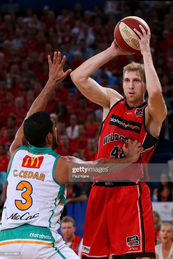Shawn Redhage of the Wildcats looks to pass the ball against Chris Cedar of the Crocodiles during the round 19 NBL match between the Perth Wildcats and the Townsville Crocodiles at Perth Arena on February 15, 2013 in Perth, Australia.