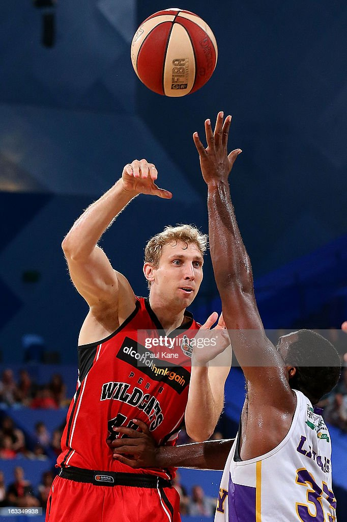 Shawn Redhage of the Wildcats passes the ball against Darnell Lazare of the Kings during the round 22 NBL match between the Perth Wildcats and the Sydney Kings at Perth Arena on March 8, 2013 in Perth, Australia.
