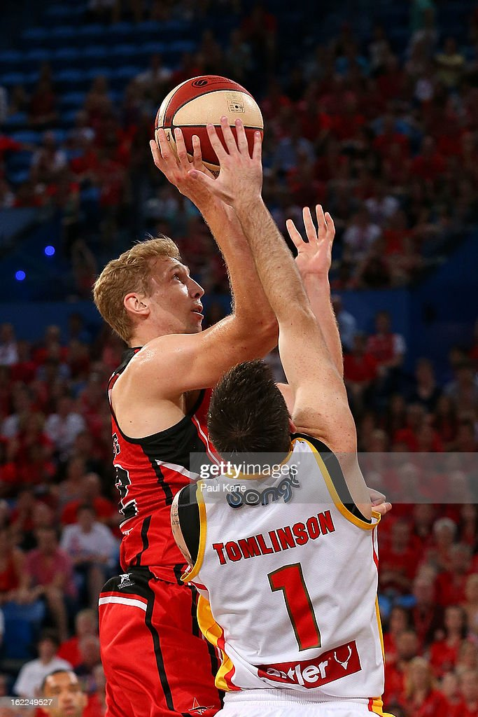 Shawn Redhage of the Wildcats shoots against Nate Tomlinson of the Tigers during the round 20 NBL match between the Perth Wildcats and the Melbourne Tigers at Perth Arena on February 21, 2013 in Perth, Australia.