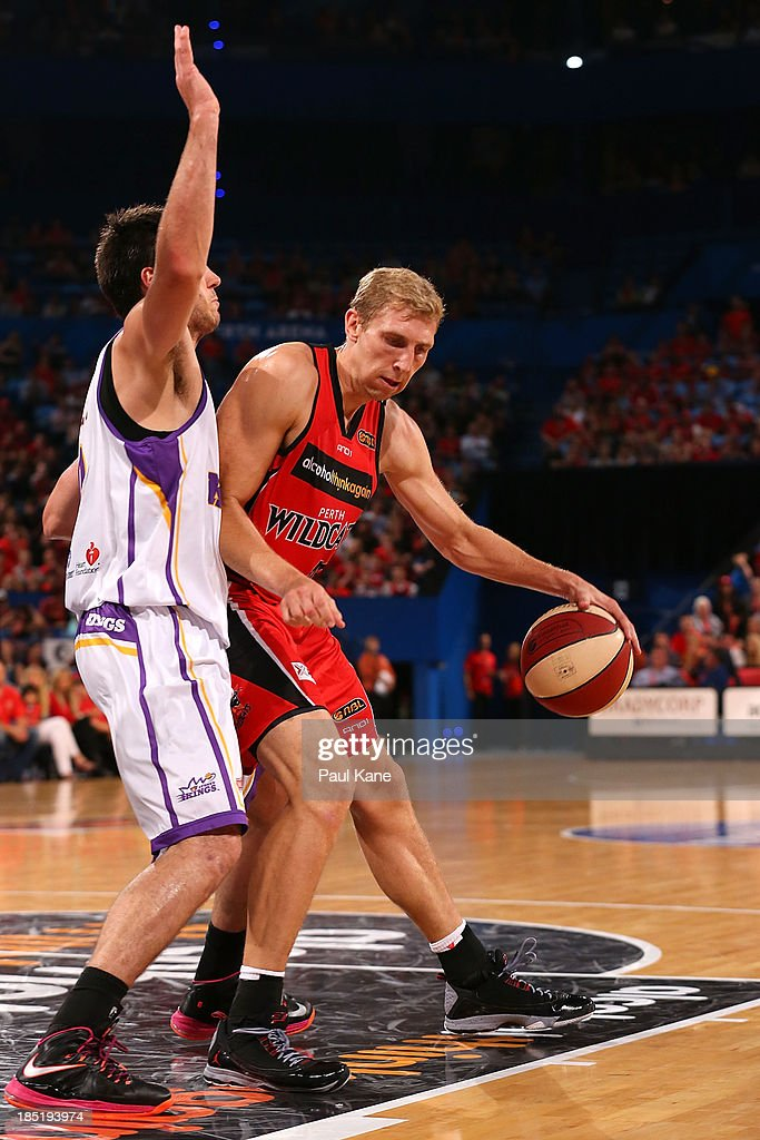 Shawn Redhage of the Wildcats works to the basket against Brad Hill of the Kings during the round two NBL match between the Perth Wildcats and the Sydney Kings at Perth Arena in October 18, 2013 in Perth, Australia.