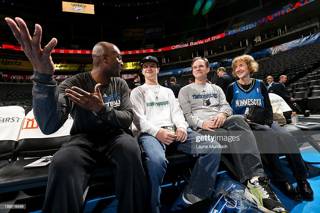 Shawn Respert, player development coach for the Minnesota Timberwolves, left, speaks with Cody Metz, center, and his family, who were in attendance through the Make-A-Wish Foundation, before a game between the Timberwolves and Oklahoma City Thunder on January 9, 2013 at the Chesapeake Energy Arena in Oklahoma City, Oklahoma.