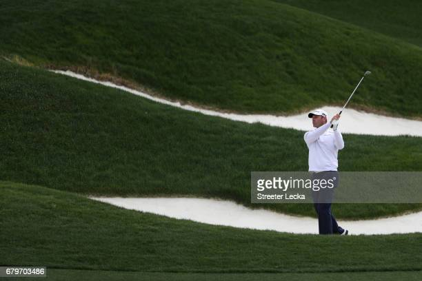 Shawn Stefani plays a shot from a bunker on the third hole during round three of the Wells Fargo Championship at Eagle Point Golf Club on May 6 2017...
