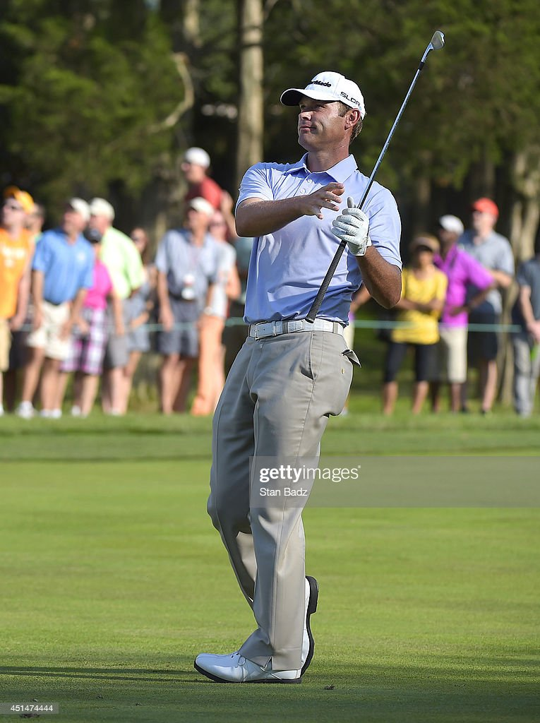 Shawn Stefani reacts to his second shot on the 18th fairway during the final round of the Quicken Loans National at Congressional Country Club on June 29, 2014 in Bethesda, Maryland.