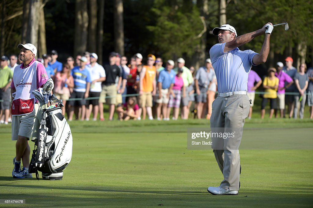 Shawn Stefani watches his second shot on the 18th fairway during the final round of the Quicken Loans National at Congressional Country Club on June 29, 2014 in Bethesda, Maryland.
