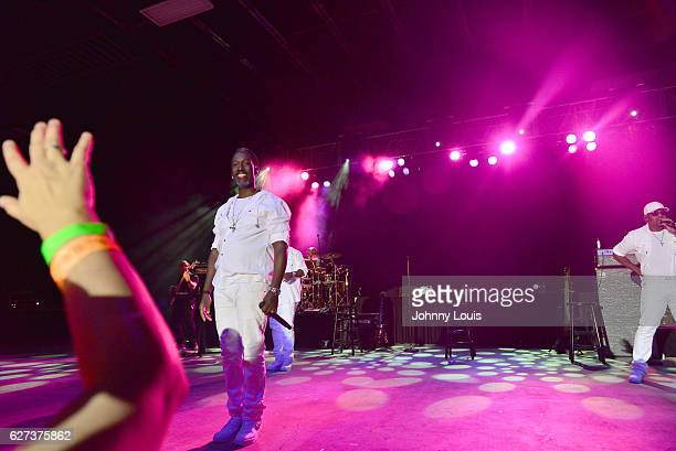 Shawn Stockman and Nathan Morris of Boyz II Men perform onstage at Pompano Beach Amphitheatre on December 2 2016 in Pompano Beach Florida