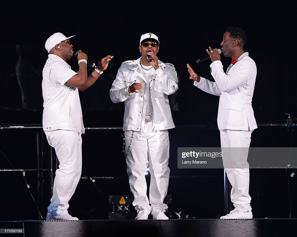Shawn Stockman, Wanya Morris and Nathan Morris of Boys II Men perform during The Package Tour at BB&T Center on June 22, 2013 in Sunrise, Florida.