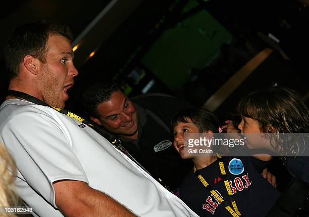 Shawn Thornton and Maggie attend the Beckett Bowl at Children's Hospital Boston on July 29 2010 in Boston Massachusetts