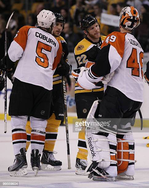 Shawn Thornton and Milan Lucic of the Boston Bruins congratulate Braydon Coburn and Michael Leighton of the Philadelphia Flyers in Game Seven of the...