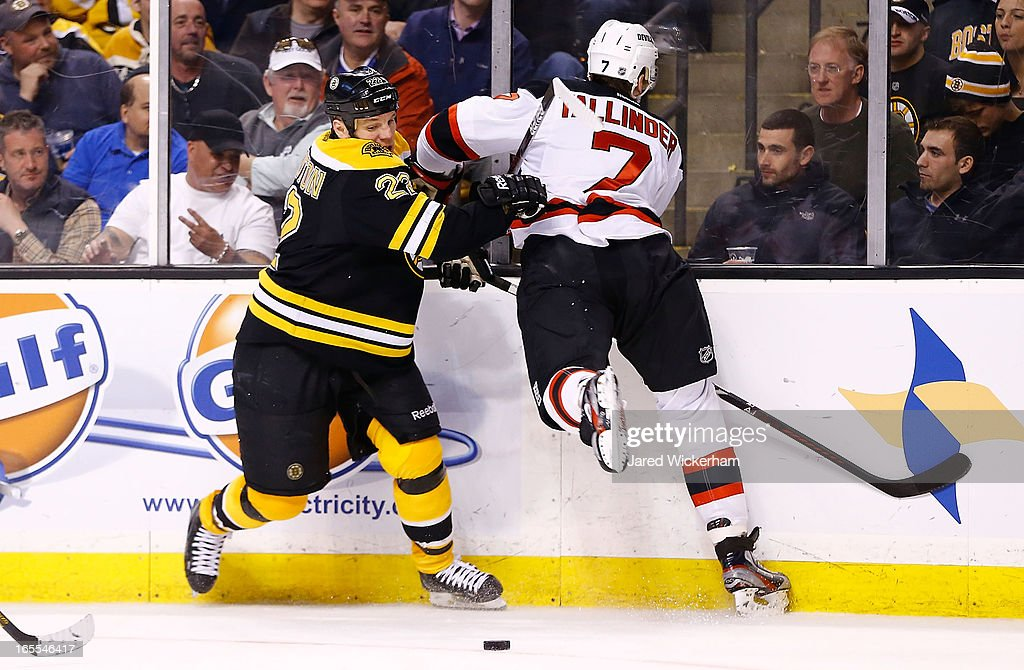 <a gi-track='captionPersonalityLinkClicked' href=/galleries/search?phrase=Shawn+Thornton&family=editorial&specificpeople=221639 ng-click='$event.stopPropagation()'>Shawn Thornton</a> #22 of the Boston Bruins and <a gi-track='captionPersonalityLinkClicked' href=/galleries/search?phrase=Henrik+Tallinder&family=editorial&specificpeople=204661 ng-click='$event.stopPropagation()'>Henrik Tallinder</a> #7 of the New Jersey Devils battle along the boards for the puck during the game on April 2, 2013 at TD Garden in Boston, Massachusetts.
