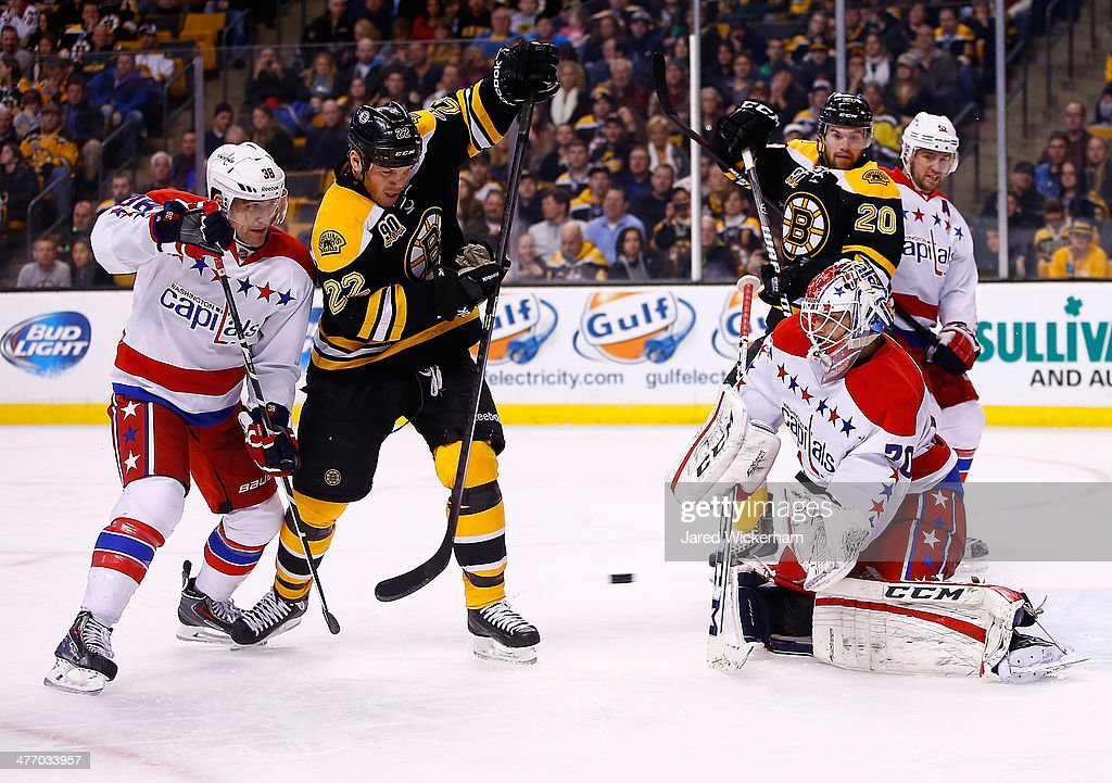 <a gi-track='captionPersonalityLinkClicked' href=/galleries/search?phrase=Shawn+Thornton&family=editorial&specificpeople=221639 ng-click='$event.stopPropagation()'>Shawn Thornton</a> #22 of the Boston Bruins attempts to deflect a shot in front of <a gi-track='captionPersonalityLinkClicked' href=/galleries/search?phrase=Braden+Holtby&family=editorial&specificpeople=5370964 ng-click='$event.stopPropagation()'>Braden Holtby</a> #70 of the Washington Capitals in the third period during the game at TD Garden on March 6, 2014 in Boston, Massachusetts.