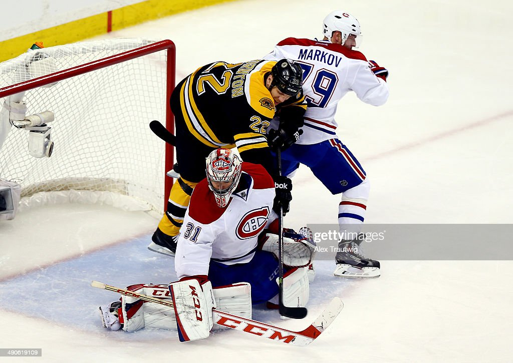Shawn Thornton #22 of the Boston Bruins battles with Carey Price #31 and Andrei Markov #79 of the Montreal Canadiens during Game Seven of the Second Round of the 2014 NHL Stanley Cup Playoffs at the TD Garden on May 14, 2014 in Boston, Massachusetts.