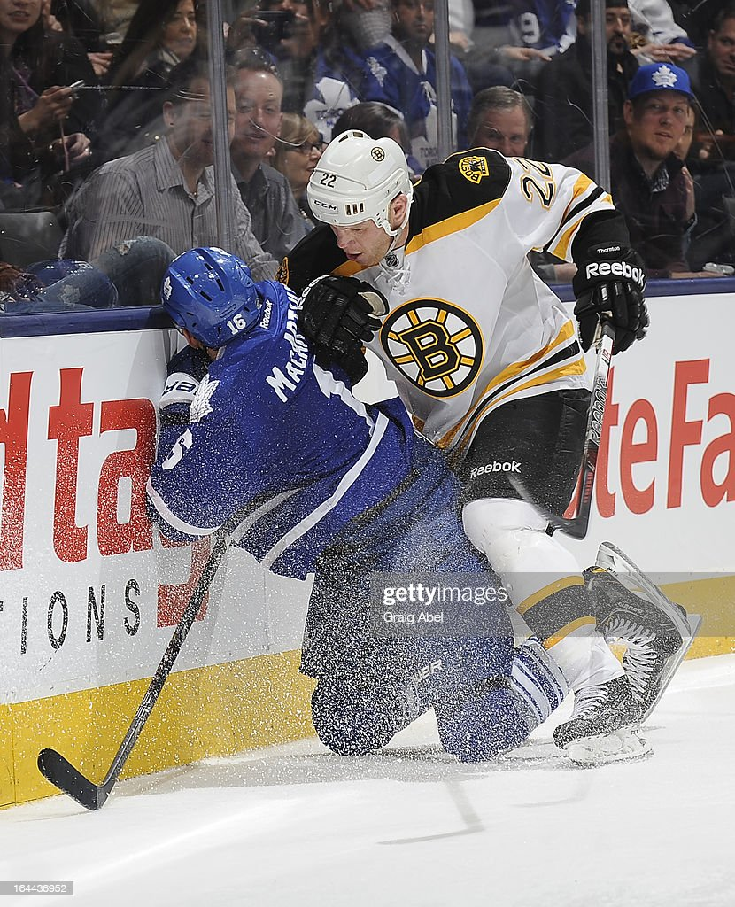 Shawn Thornton #22 of the Boston Bruins checks Clarke MacArthur #16 of the Toronto Maple Leafs during NHL game action March 23, 2013 at the Air Canada Centre in Toronto, Ontario, Canada.