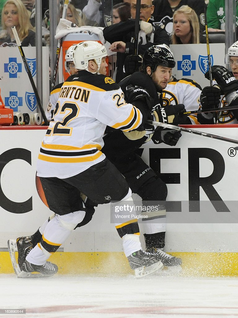 <a gi-track='captionPersonalityLinkClicked' href=/galleries/search?phrase=Shawn+Thornton&family=editorial&specificpeople=221639 ng-click='$event.stopPropagation()'>Shawn Thornton</a> # 22 of the Boston Bruins checks <a gi-track='captionPersonalityLinkClicked' href=/galleries/search?phrase=Tanner+Glass&family=editorial&specificpeople=4596666 ng-click='$event.stopPropagation()'>Tanner Glass</a> # 10 of the Pittsburgh Penguins during the third period on February 17, 2013 at the CONSOL Energy Center in Pittsburgh, Pennsylvania.