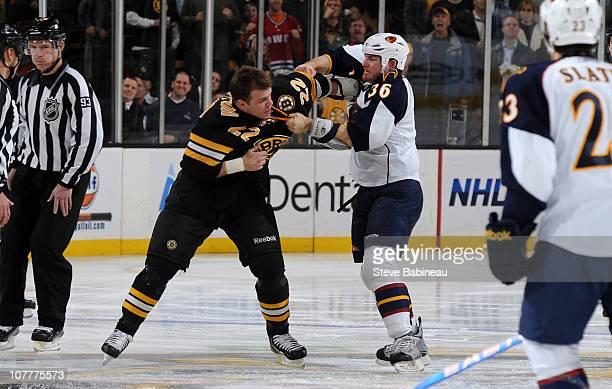 Shawn Thornton of the Boston Bruins fights against Eric Boulton of the Atlanta Thrashers at the TD Garden on December 23 2010 in Boston Massachusetts