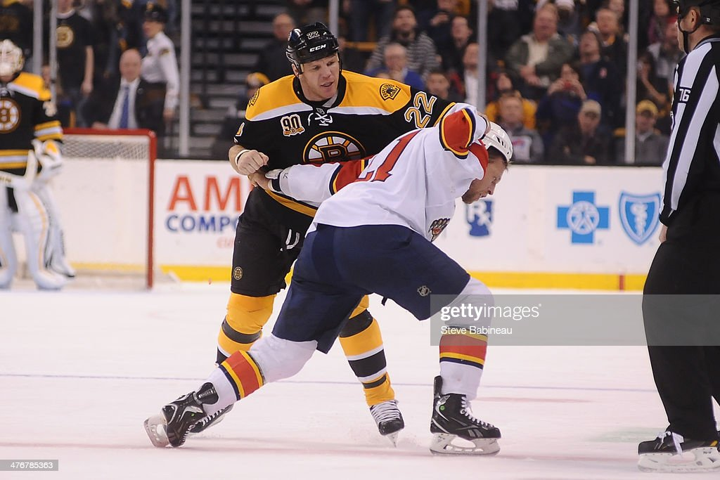 Shawn Thornton of the Boston Bruins fights against Krys Barch of the Florida Panthers at the TD Garden on March 4 2014 in Boston Massachusetts