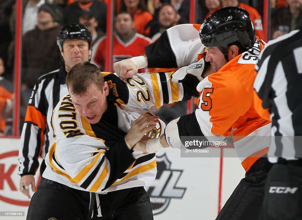 Shawn Thornton #22 of the Boston Bruins fights Jody Shelley #45 of the Philadelphia Flyers during their game on January 22, 2012 at Wells Fargo Center in Philadelphia, Pennsylvania.