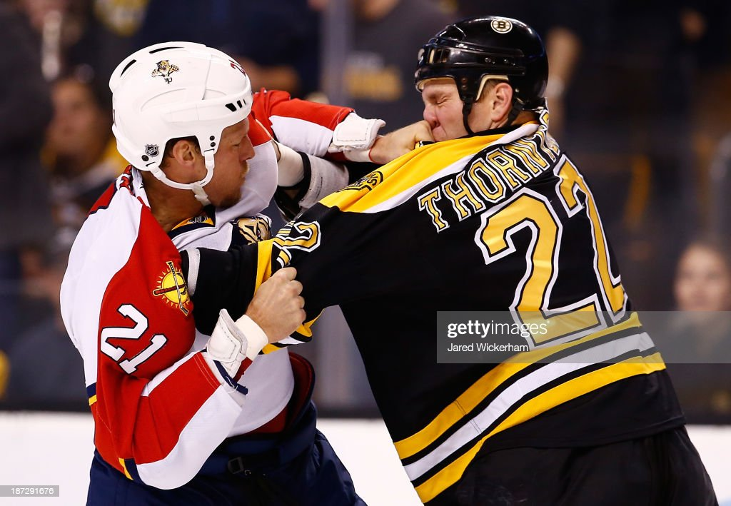 <a gi-track='captionPersonalityLinkClicked' href=/galleries/search?phrase=Shawn+Thornton&family=editorial&specificpeople=221639 ng-click='$event.stopPropagation()'>Shawn Thornton</a> #22 of the Boston Bruins fights <a gi-track='captionPersonalityLinkClicked' href=/galleries/search?phrase=Krys+Barch&family=editorial&specificpeople=2538220 ng-click='$event.stopPropagation()'>Krys Barch</a> #21 of the Florida Panthers in the second period at TD Garden on November 7, 2013 in Boston, Massachusetts.