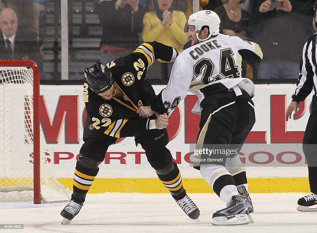 Shawn Thornton of the Boston Bruins fights with Matt Cooke of the Pittsburgh Penguins at the TD Garden on March 18 2010 in Boston Massachusetts The...