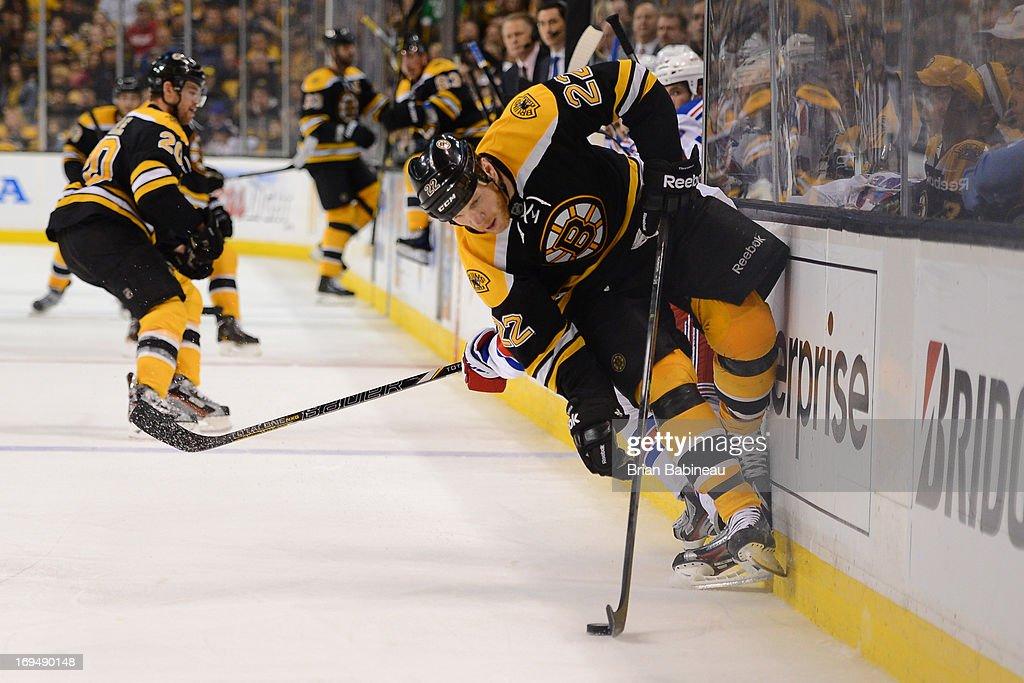 <a gi-track='captionPersonalityLinkClicked' href=/galleries/search?phrase=Shawn+Thornton&family=editorial&specificpeople=221639 ng-click='$event.stopPropagation()'>Shawn Thornton</a> #22 of the Boston Bruins handles the puck against the New York Rangers in Game Five of the Eastern Conference Semifinals during the 2013 NHL Stanley Cup Playoffs at TD Garden on May 25, 2013 in Boston, Massachusetts.