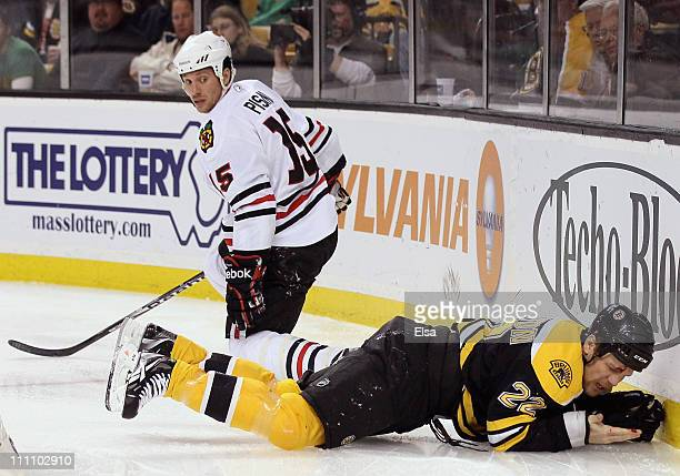 Shawn Thornton of the Boston Bruins lies on the ice after hitting the skate from Fernando Pisani of the Chicago Blackhawks in the second period on...