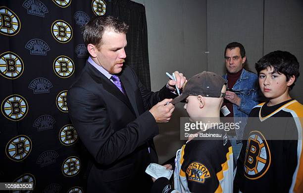 Shawn Thornton of the Boston Bruins meets with cancer patients in honor of Hockey Fights Cancer post game against the New York Rangers at the TD...