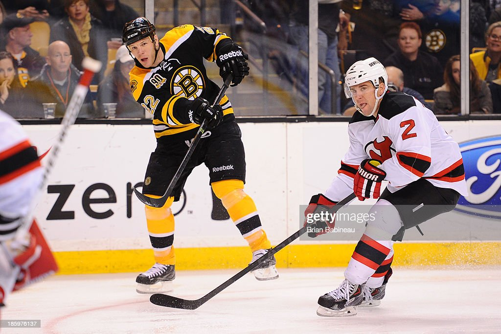 <a gi-track='captionPersonalityLinkClicked' href=/galleries/search?phrase=Shawn+Thornton&family=editorial&specificpeople=221639 ng-click='$event.stopPropagation()'>Shawn Thornton</a> #22 of the Boston Bruins shoots the puck against Marek Zidlucky #2 of the New Jersey Devils at the TD Garden on October 26, 2013 in Boston, Massachusetts.