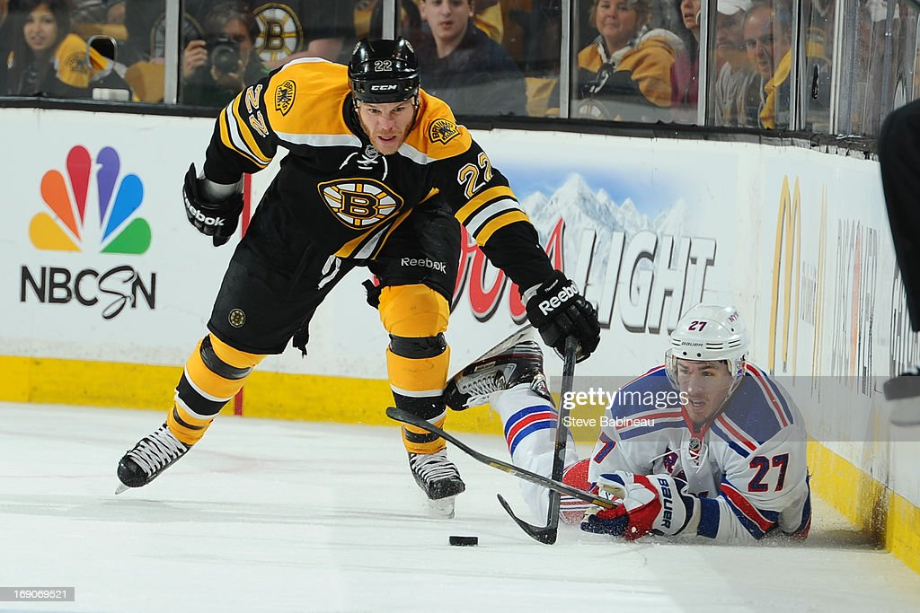 <a gi-track='captionPersonalityLinkClicked' href=/galleries/search?phrase=Shawn+Thornton&family=editorial&specificpeople=221639 ng-click='$event.stopPropagation()'>Shawn Thornton</a> #22 of the Boston Bruins skates after the puck against <a gi-track='captionPersonalityLinkClicked' href=/galleries/search?phrase=Ryan+McDonagh&family=editorial&specificpeople=4324983 ng-click='$event.stopPropagation()'>Ryan McDonagh</a> #27 of the New York Rangers in Game Two of the Eastern Conference Semifinals during the 2013 NHL Stanley Cup Playoffs at TD Garden on May 19, 2013 in Boston, Massachusetts.