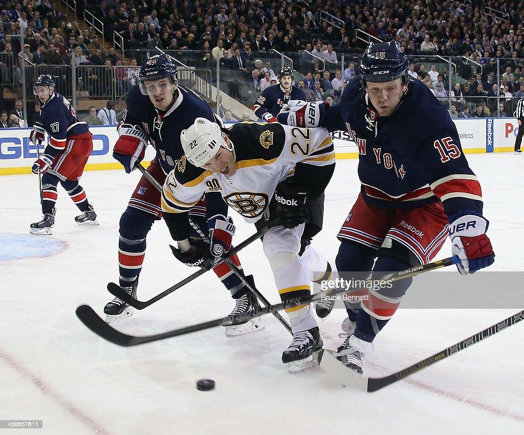 Shawn Thornton #22 of the Boston Bruins splits through Justin Falk #44 and Derek Dorsett #15 of the New York Rangers at Madison Square Garden on November 19, 2013 in New York City. The Bruins defeated the Rangers 2-1.