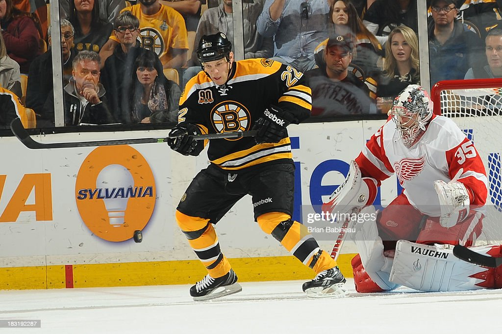 <a gi-track='captionPersonalityLinkClicked' href=/galleries/search?phrase=Shawn+Thornton&family=editorial&specificpeople=221639 ng-click='$event.stopPropagation()'>Shawn Thornton</a> #22 of the Boston Bruins watches the loose puck against <a gi-track='captionPersonalityLinkClicked' href=/galleries/search?phrase=Jimmy+Howard&family=editorial&specificpeople=2118637 ng-click='$event.stopPropagation()'>Jimmy Howard</a> #35 of the Detroit Red Wings at the TD Garden on October 5, 2013 in Boston, Massachusetts.