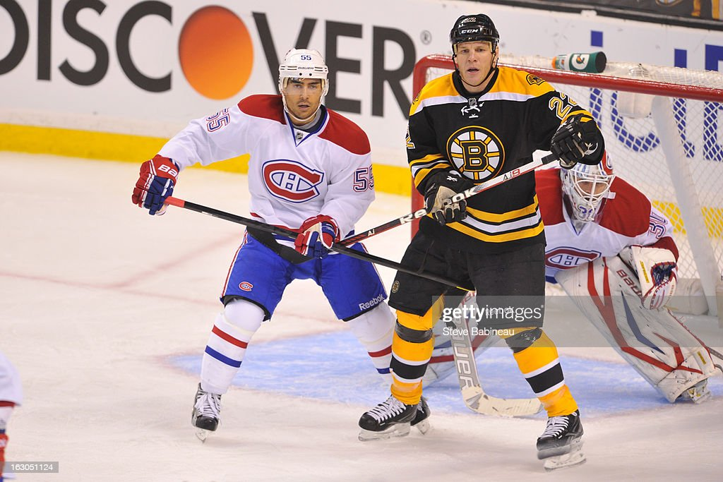 <a gi-track='captionPersonalityLinkClicked' href=/galleries/search?phrase=Shawn+Thornton&family=editorial&specificpeople=221639 ng-click='$event.stopPropagation()'>Shawn Thornton</a> #22 of the Boston Bruins watches the play against <a gi-track='captionPersonalityLinkClicked' href=/galleries/search?phrase=Francis+Bouillon&family=editorial&specificpeople=215165 ng-click='$event.stopPropagation()'>Francis Bouillon</a> #55 of the Montreal Canadiens at the TD Garden on March 3, 2013 in Boston, Massachusetts.