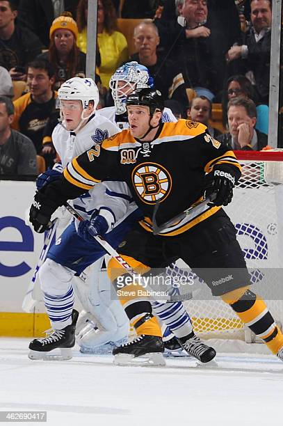 Shawn Thornton of the Boston Bruins watches the play against Morgan Rielly of the Toronto Maple Leafs at the TD Garden on January 14 2014 in Boston...