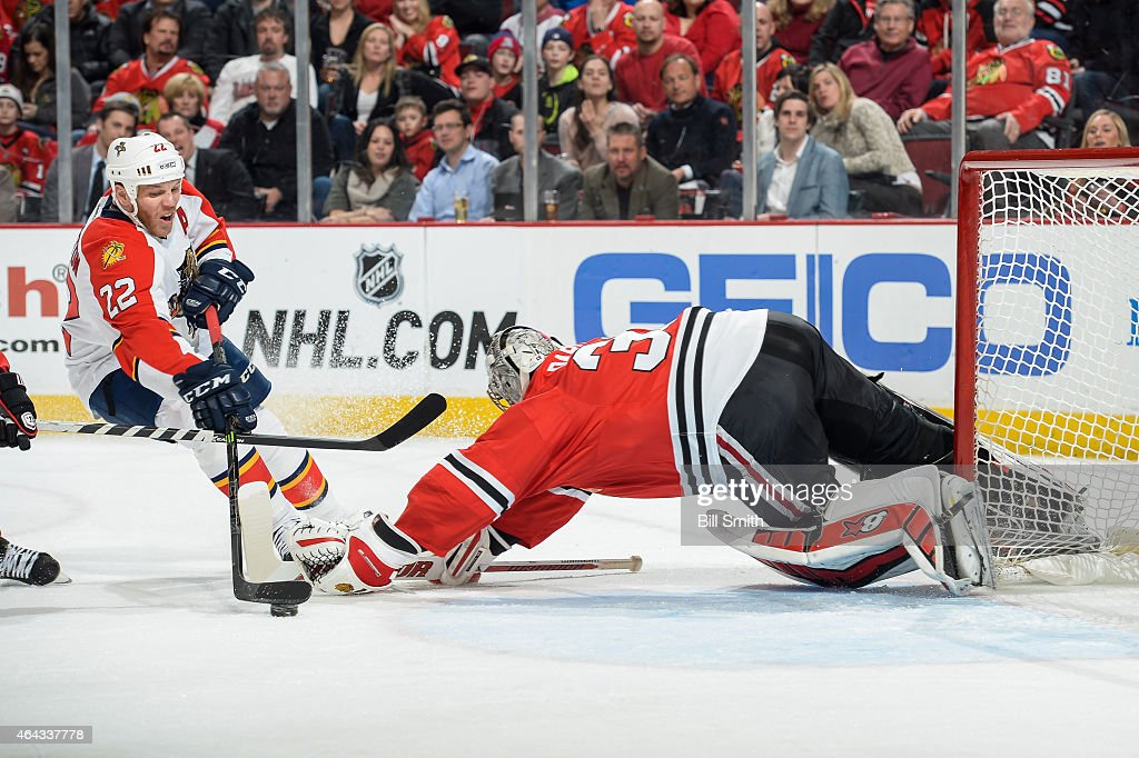 Shawn Thornton #22 of the Florida Panthers attempts to score on goalie Scott Darling #33 of the Chicago Blackhawks during the NHL game at the United Center on February 24, 2015 in Chicago, Illinois.
