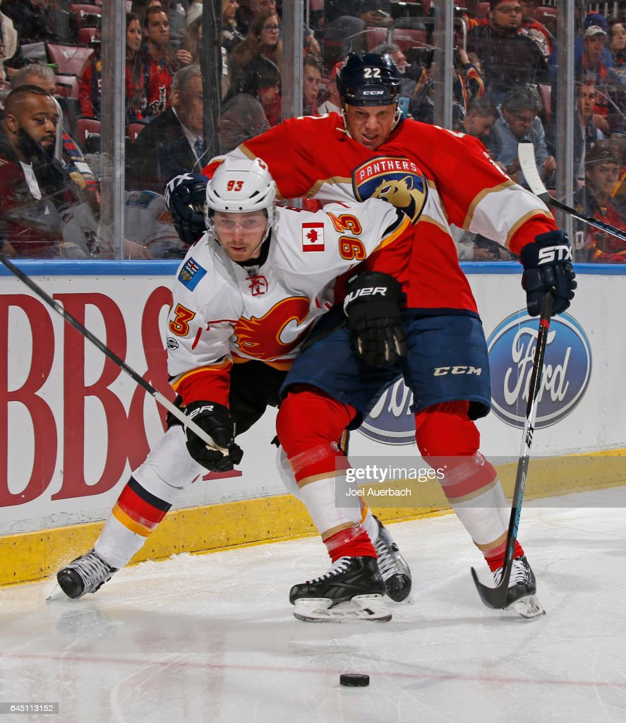 Shawn Thornton #22 of the Florida Panthers checks Sam Bennett #93 of the Calgary Flames as he attempts to chase a loose puck during second period action at the BB&T Center on February 24, 2017 in Sunrise, Florida. The Flames defeated the Panthers 4-2.