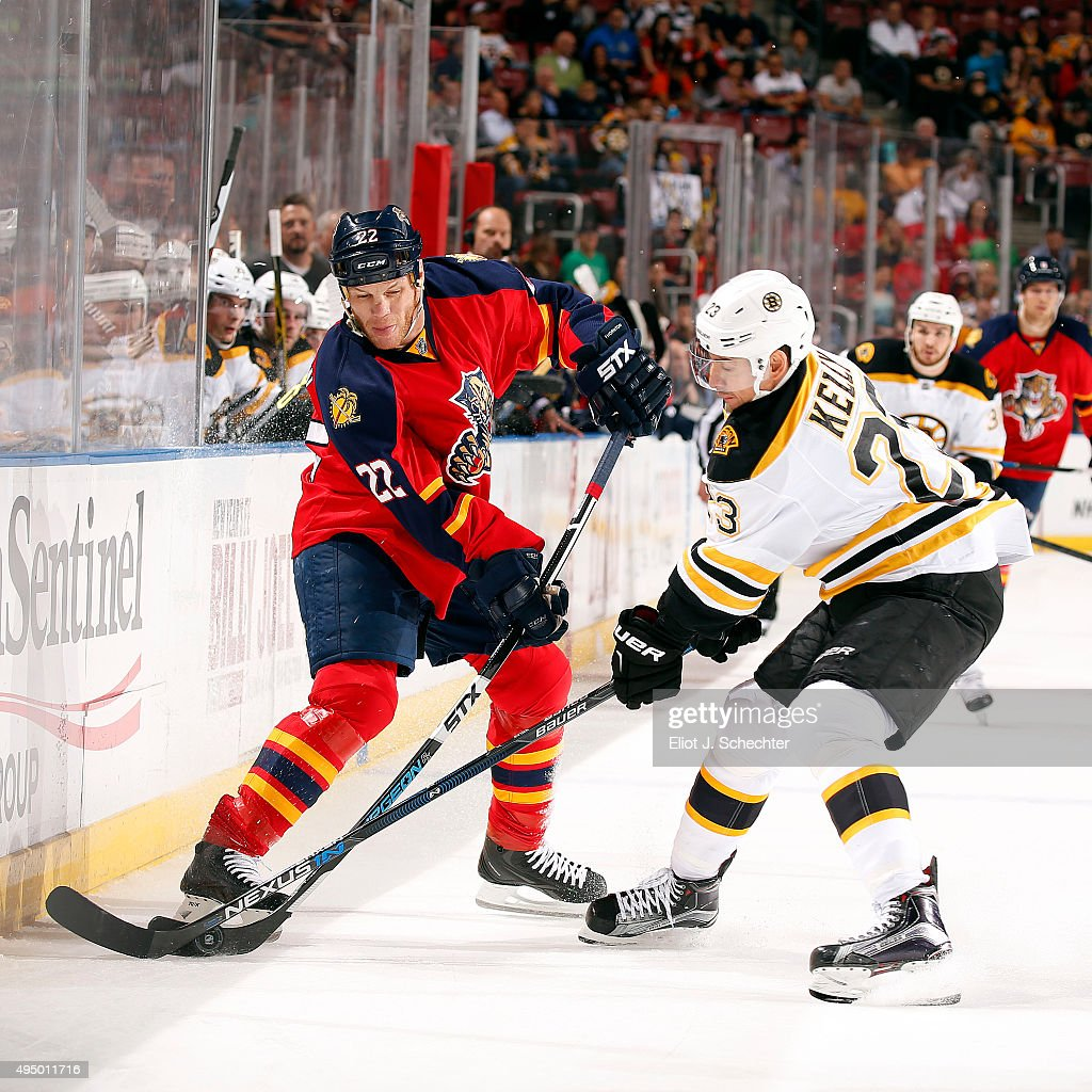 Shawn Thornton of the Florida Panthers crosses sticks with Chris Kelly of the Boston Bruins at the BBT Center on October 30 2015 in Sunrise Florida