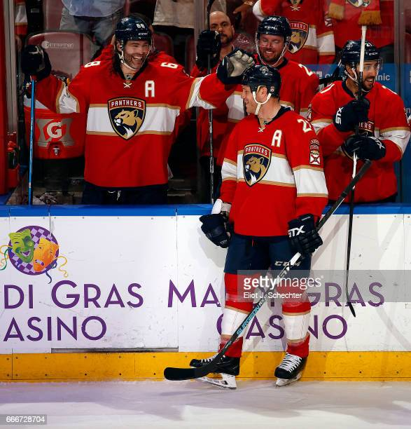 Shawn Thornton of the Florida Panthers gets a pat on the head by teammate Jaromir Jagr after a video tribute Shawn Thornton played his last NHL game...