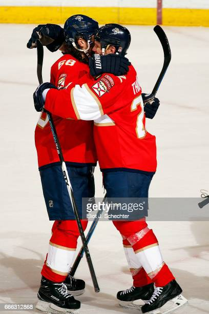 Shawn Thornton of the Florida Panthers hugs teammate Jaromir Jagr after their 30 win against the Buffalo Sabres at the BBT Center on April 8 2017 in...