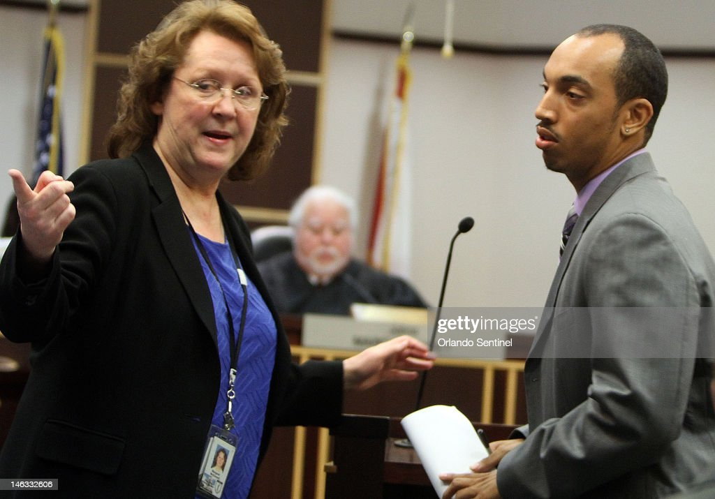 Shawn Turner, Florida A&M University marching band drum major, right, appears in court with appointed public defender Margaret McDonnell at an arraignment, Thursday, June 14, 2012, in Orlando, Florida, as Judge Marc Lubet looks on in background. Judge Lubet set an October trial date for 11 people, including Turner, charged with felony hazing in the death of a Florida A&M drum major Robert Champion.