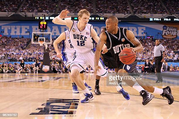 Shawn Vanzant of the Butler Bulldogs drives on Kyle Singler of the Duke Blue Devils in the second half during the 2010 NCAA Division I Men's...