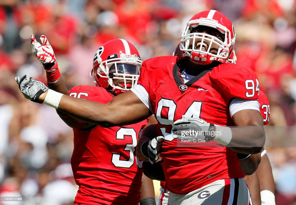 Shawn Williams and DeAngelo Tyson of the Georgia Bulldogs against the Mississippi State Bulldogs at Sanford Stadium on October 1 2011 in Athens...