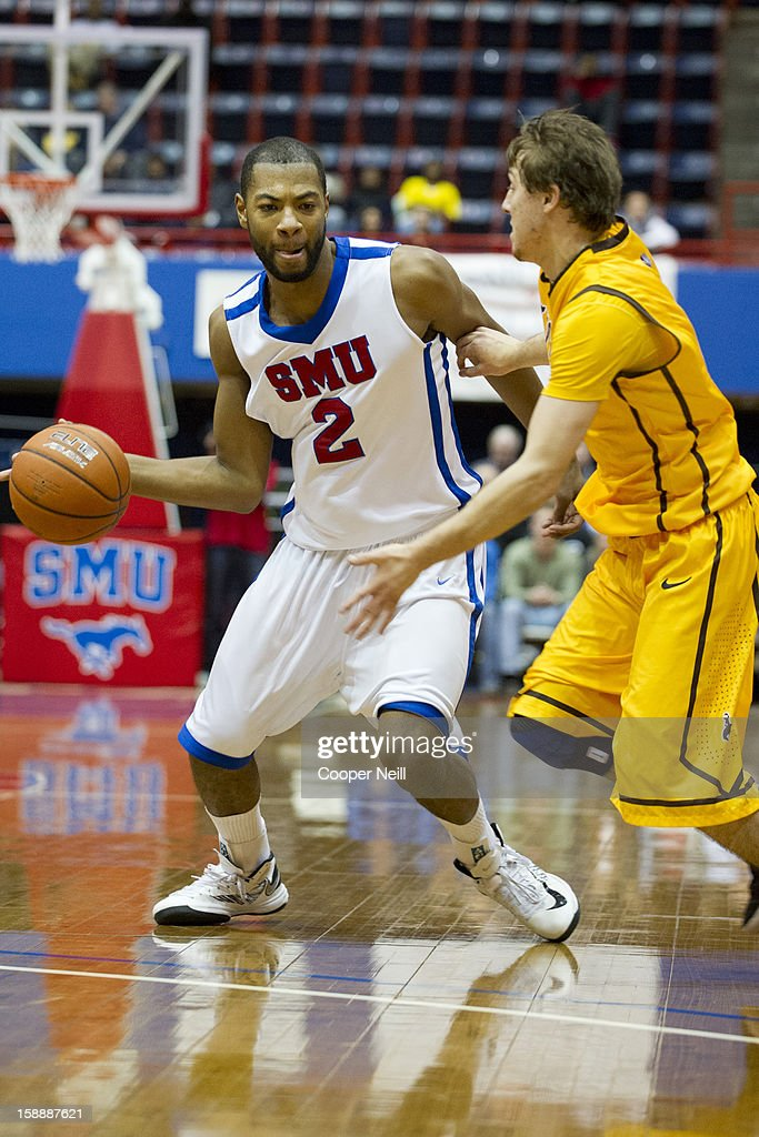 Shawn Williams #2 of the SMU Mustangs drives to the basket against the Wyoming Cowboys on January 2, 2013 at the Moody Coliseum in Dallas, Texas.