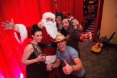 Shawna Thompson Santa Claus Dustin Lynch Jerrod Niemann and Keifer Thompson pose backstage after performing for the Hometown Holiday show hosted by...