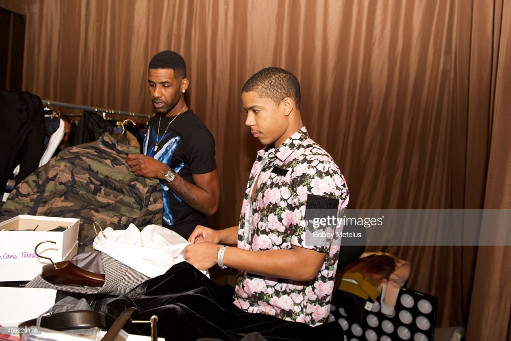 <a gi-track='captionPersonalityLinkClicked' href=/galleries/search?phrase=Shawne+Williams&family=editorial&specificpeople=728608 ng-click='$event.stopPropagation()'>Shawne Williams</a> and <a gi-track='captionPersonalityLinkClicked' href=/galleries/search?phrase=Andre+Dawkins&family=editorial&specificpeople=6543120 ng-click='$event.stopPropagation()'>Andre Dawkins</a> backstage at the 'A Night On The Runwade' fundrasing event at Ice Palace Film Studios on November 18, 2014 in Miami, Florida.